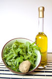 A white truffle, oil and salad Stock Images