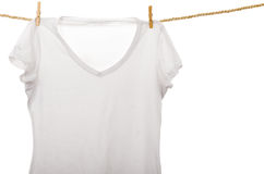 White tshirt hanging on a rope clothesline Royalty Free Stock Photography