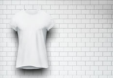 White tshirt isolated on the wall of bricks Stock Photo