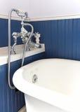 White tub with antique hardware. Royalty Free Stock Photo