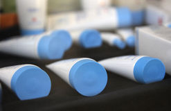 White tubes on counter. Royalty Free Stock Photo