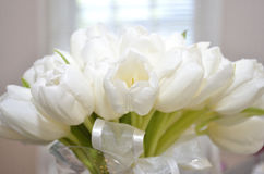White tulip bouquet in white room Royalty Free Stock Photo