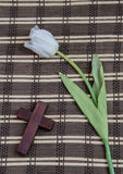 White tulip and wooden cross Royalty Free Stock Photos