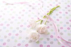 White tulips. Three White tulips and pink ribbon on pop background Royalty Free Stock Images