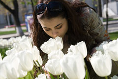 White Tulips. A girl smelling white tulips Royalty Free Stock Photos