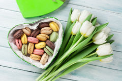 White tulips bouquet and gift box with macaroons Stock Image