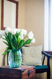 White tulips. Bouquet of white tulips in the interior, room decor Royalty Free Stock Images