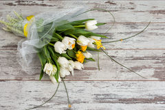 White tulips bouquet on wooden background. Spring bouquet of white tulips stock photography