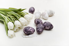 White tulips and easter eggs Stock Images