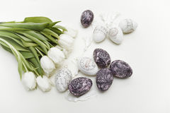 White tulips and easter eggs Stock Photos