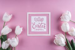White tulips flowers on pink background with Easter card. Waiting for spring. Royalty Free Stock Images