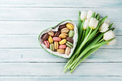 White tulips and gift box with macaroons Stock Photo