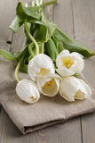 White tulips on old wood table Royalty Free Stock Image