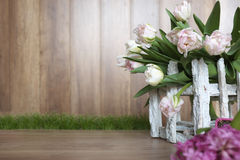 White tulips with wood background Royalty Free Stock Photos