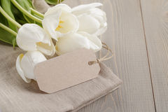 White tulips on wood table Stock Photography