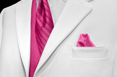 White tuxedo with pink tie Stock Images