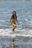 White tween girl in the ankle water of the ocean. Royalty Free Stock Photography