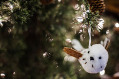 White tweety bird on Christmas tree Royalty Free Stock Image