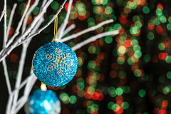 White twigs with Christmas tree baubles Stock Photos