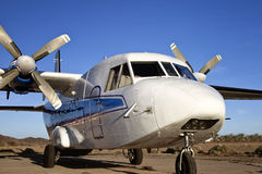 White Twin Propeller Plane. White and blue, twin propeller cargo aircraft stock images