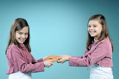 White twin sisters fighting for handmade masque Royalty Free Stock Photo