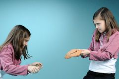 White twin sisters having conflict. White twin sisters in conflict for handmade masque Stock Photography