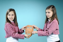 White twin sisters showing handmade masque Royalty Free Stock Photography