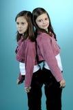 White twins posing in studio Stock Photo