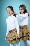 White twins sisters weaving hair Stock Image