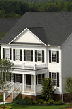 White Two-Story House. A New Traditional Style Two-Story House royalty free stock images