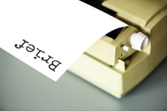 White Typewriter on Gray Table Royalty Free Stock Images
