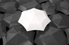 White umbrella among black umbrellas Stock Images