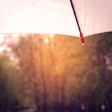 White umbrella with a drop of rain - vintage effect. Royalty Free Stock Image