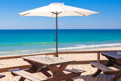 White umbrella in the empty bar at sea outdoors Stock Image