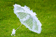 White umbrella on a green background. Love wedding Royalty Free Stock Images