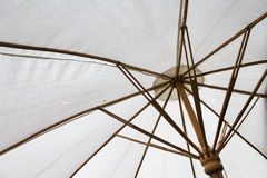 White umbrella. Inside umbrella that made from unbleached cloth Royalty Free Stock Images