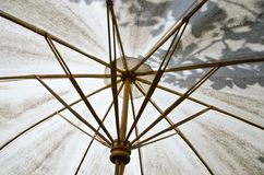 White umbrella made of bamboo and fabric. Royalty Free Stock Photo