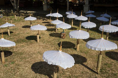 White umbrella. Placed for dring in sun Royalty Free Stock Photos