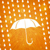 White umbrella and rain drops on abstract  orange background Stock Photo