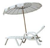 White umbrella and sun lounger Stock Photos