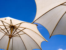 White umbrella under blue sky Stock Image
