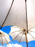 White umbrella under blue sky Royalty Free Stock Images