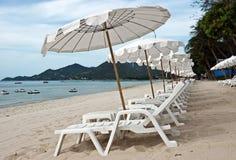 White umbrellas at the beach Stock Photo