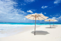 Umbrellas on tropical beach. White umbrellas on a beautiful tropical beach at Anguilla, Caribbean Stock Photography