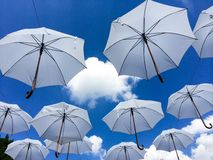 White umbrellas. In blue sky Stock Photography