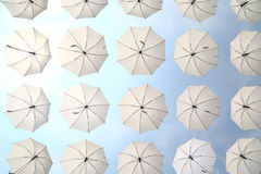 White umbrellas and blue sky Royalty Free Stock Image