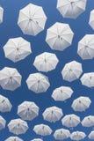 White umbrellas on blue sky Royalty Free Stock Image