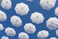 White umbrellas on blue sky Royalty Free Stock Photo