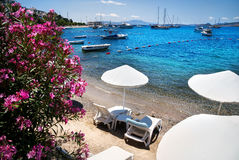 White Umbrellas on the Bodrum beach Stock Photography