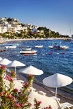 White Umbrellas on the Bodrum beach Royalty Free Stock Photo